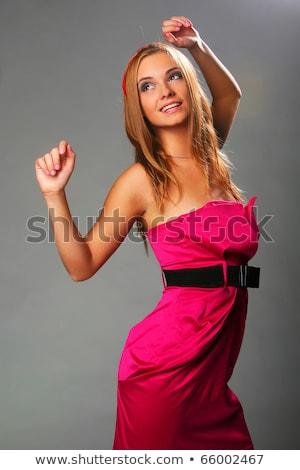 Fille rose robe séjour gris Photo stock © AntonRomanov