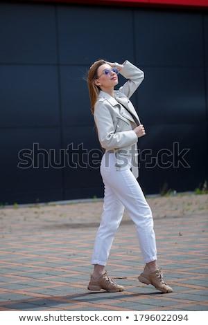Sevimli gülen kız gri bluz kot Stok fotoğraf © Elnur