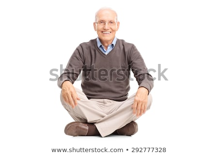 mature man seated in studio background looking at the camera Stock photo © feedough