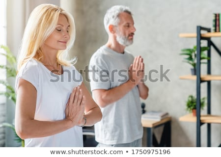 Elderly woman practicing yoga Stock photo © ambro