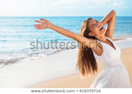 Blissful woman enjoying the summer sun Stock photo © dash