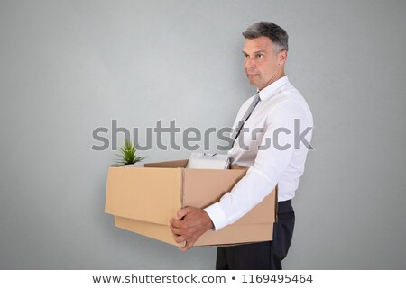 Fired Businessman Carrying a box Stock photo © artisticco