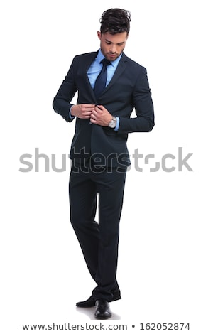 serious young business man unbuttoning his suit  Stock photo © feedough
