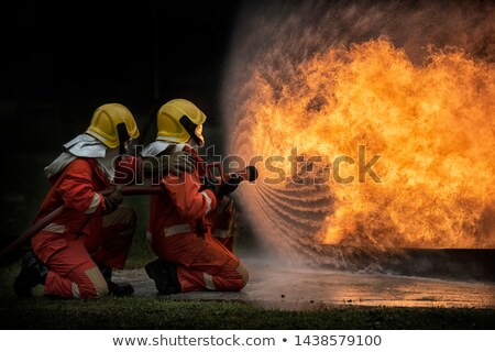 Two firemen putting out the fire Stock photo © bluering