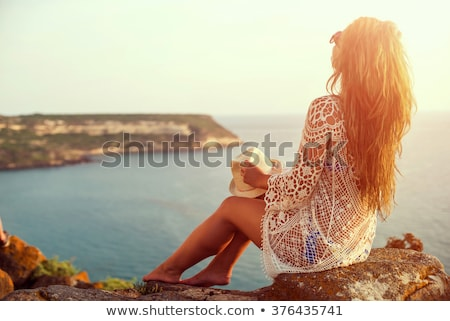 girl in summer vacation on beach looking over the sea stock photo © kzenon