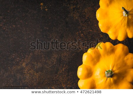 Yellow fresh pattypan squash at the right of the rusty metal background horizontal Stock photo © Karpenkovdenis