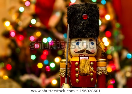 nutcracker in front of a christmas tree stock photo © brianguest