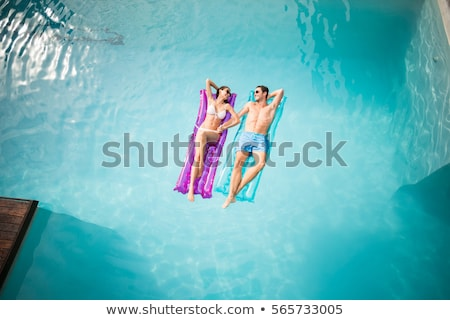 Man and woman on floating raft Stock photo © bluering