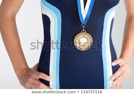 part of swimmer with gold medal Stock photo © ssuaphoto