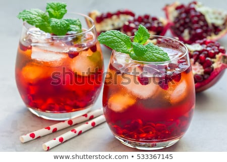 lemon mojito cocktail with mint and pomegranate cold refreshing drink or beverage stock photo © yelenayemchuk