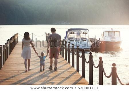 young family and son walk along the lake shore stock photo © tekso