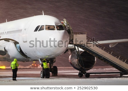 Photo stock: Airplane In Snowstorm At Night
