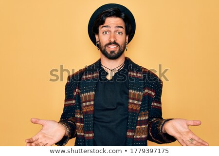 Hippie man with arm out in a welcoming gesture. Stock photo © RAStudio