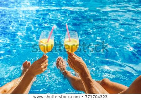 Couple Sitting On Pool Stock photo © IS2