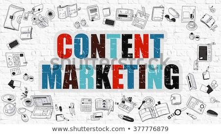 marketing concept multicolor on white brickwall stock photo © tashatuvango