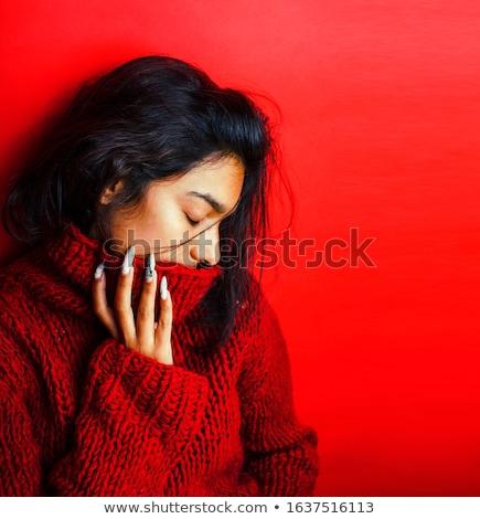 portre · gülen · genç · kız · kırmızı · kazak - stok fotoğraf © deandrobot