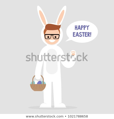 Boy in rabbit suit with the basket of easter eggs. Stock photo © RAStudio
