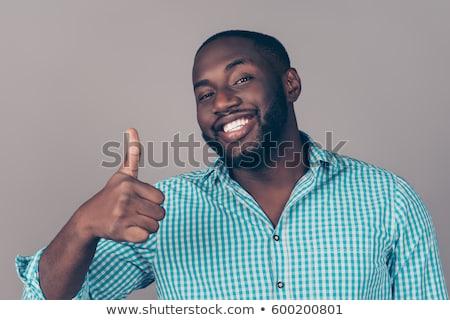 Africano barbudo empresário polegar para cima Foto stock © studioworkstock