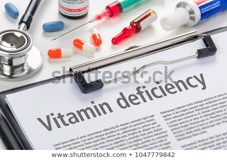 the diagnosis vitamin deficiency written on a clipboard stock photo © zerbor