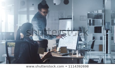 colleagues discussing project late in office Stock photo © dolgachov