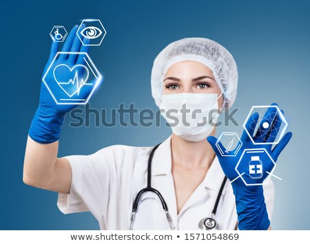 Doctor touching an icon on a futuristic interface - Disability Stock photo © Zerbor