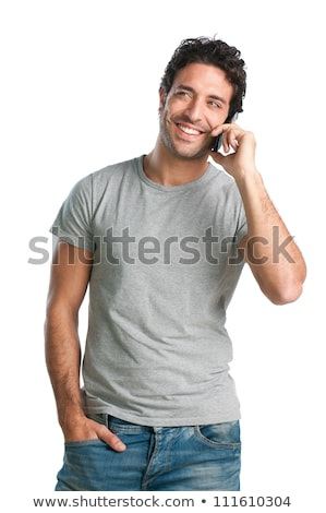 laughing young casual man talking on mobile phone stock photo © deandrobot