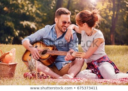Szczęśliwy młodych kochający para odkryty parku Zdjęcia stock © deandrobot