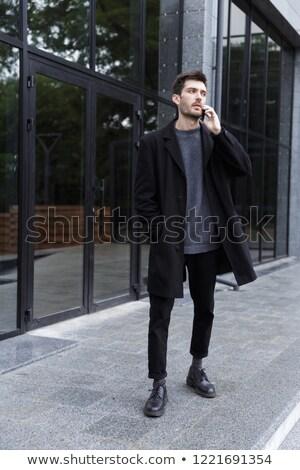 homem · caminhada · falante · celular · cidade · alegre - foto stock © deandrobot