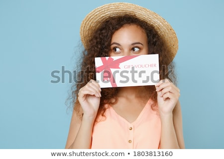Portrait of pretty woman 20s wearing casual clothes covering fac Stock photo © deandrobot