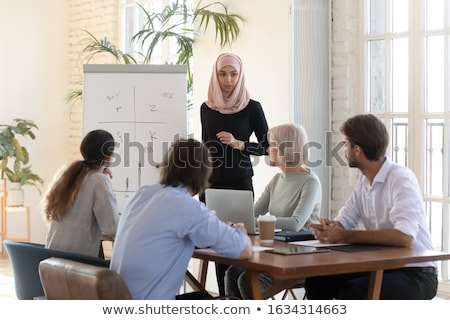 Presentation of Muslim Woman Presenter on Seminar Stock photo © robuart