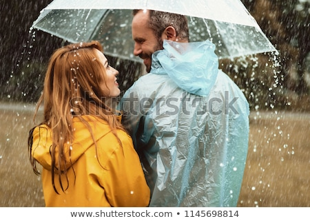 casual man and woman walking are looking at each other stock photo © feedough