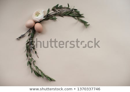 colorful decorative easter eggs wreath on white wooden table background stock photo © dash