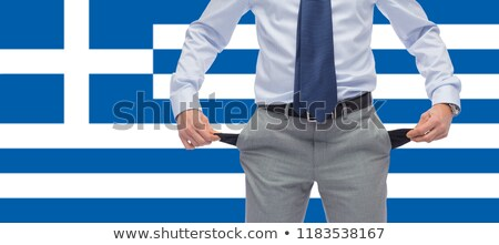 businessman with empty pockets over flag of greece Stock photo © dolgachov