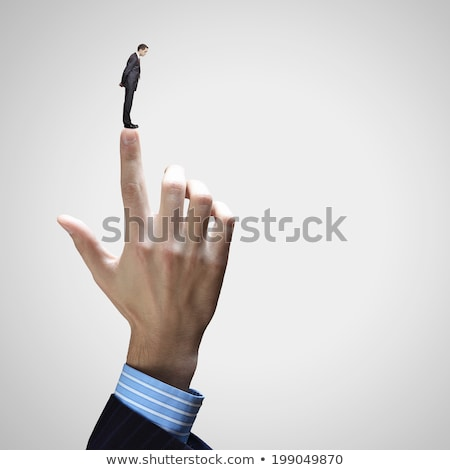 Small businessman pointing to a giant businessman Stock photo © ra2studio