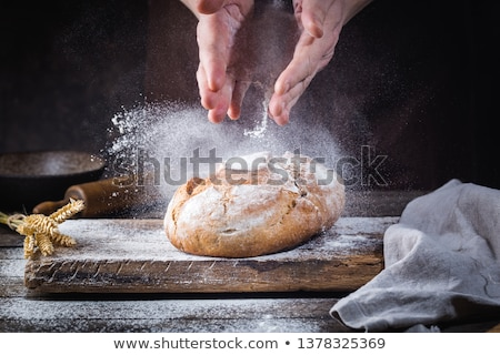 Male hands kneading fresh dough on the kitchen table stock photo © dashapetrenko