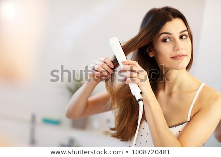 Woman Straightening Hair With Straightener Stock photo © AndreyPopov