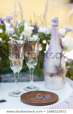 Toasting by table Stock photo © pressmaster