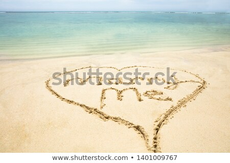 marry me text inside the heart on sand at beach stock photo © andreypopov