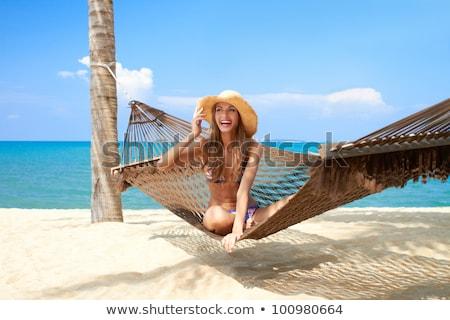 Frau bikini Sitzung Hängematte Strand Rückansicht Stock foto © AndreyPopov
