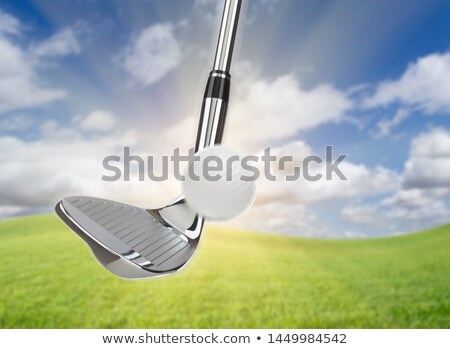 Chrome Golf Club Wedge Iron Hitting Golf Ball Against Grass and  Stock photo © feverpitch
