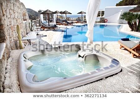 úszómedence · boldog · pár · pihen · pezsgőfürdő · fiatal - stock fotó © maridav