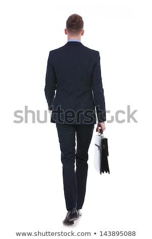 фотография молодые деловой человек ходьбе вперед портфель Сток-фото © Freedomz