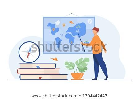 Geography Teacher with Earth Globe near Chalkboard Stock photo © robuart