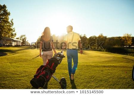 Golfe casal caminhada juntos campo de golfe feliz Foto stock © Kzenon