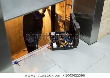 лифта ремонта человека работу сотрудник мужчин Сток-фото © Lopolo
