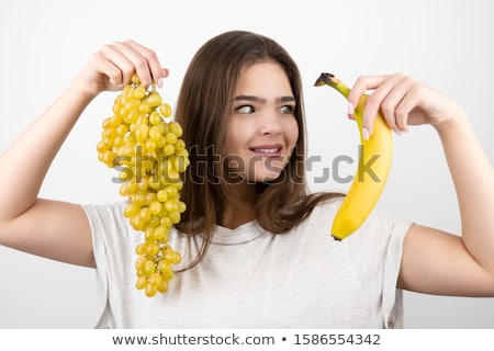 Young sporty girl holding a bunch of bananas. Healthy food and diet. The concept of proper nutrition Stock photo © serdechny