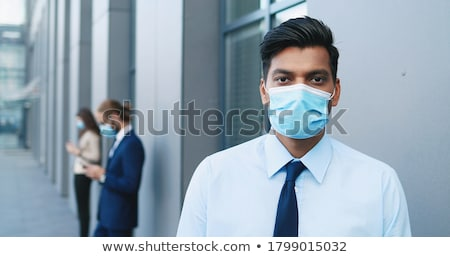 üzletember néz város távolság fiatal üzlet Stock fotó © ra2studio