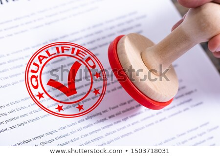 Businessman Putting Qualified Stamp On Document Stock photo © AndreyPopov