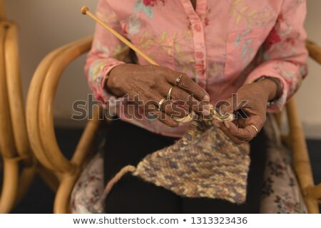 Mid section of senior woman knitting with yarn at home Stock photo © wavebreak_media