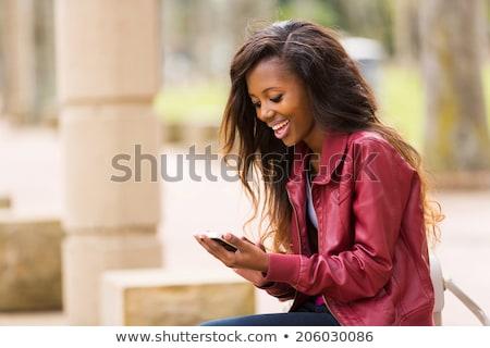 Zijaanzicht afro-amerikaanse jonge vrouw mobiele telefoon vergadering fitness Stockfoto © wavebreak_media